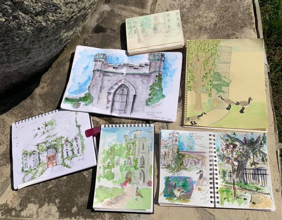 Different sketches laying on a rock
