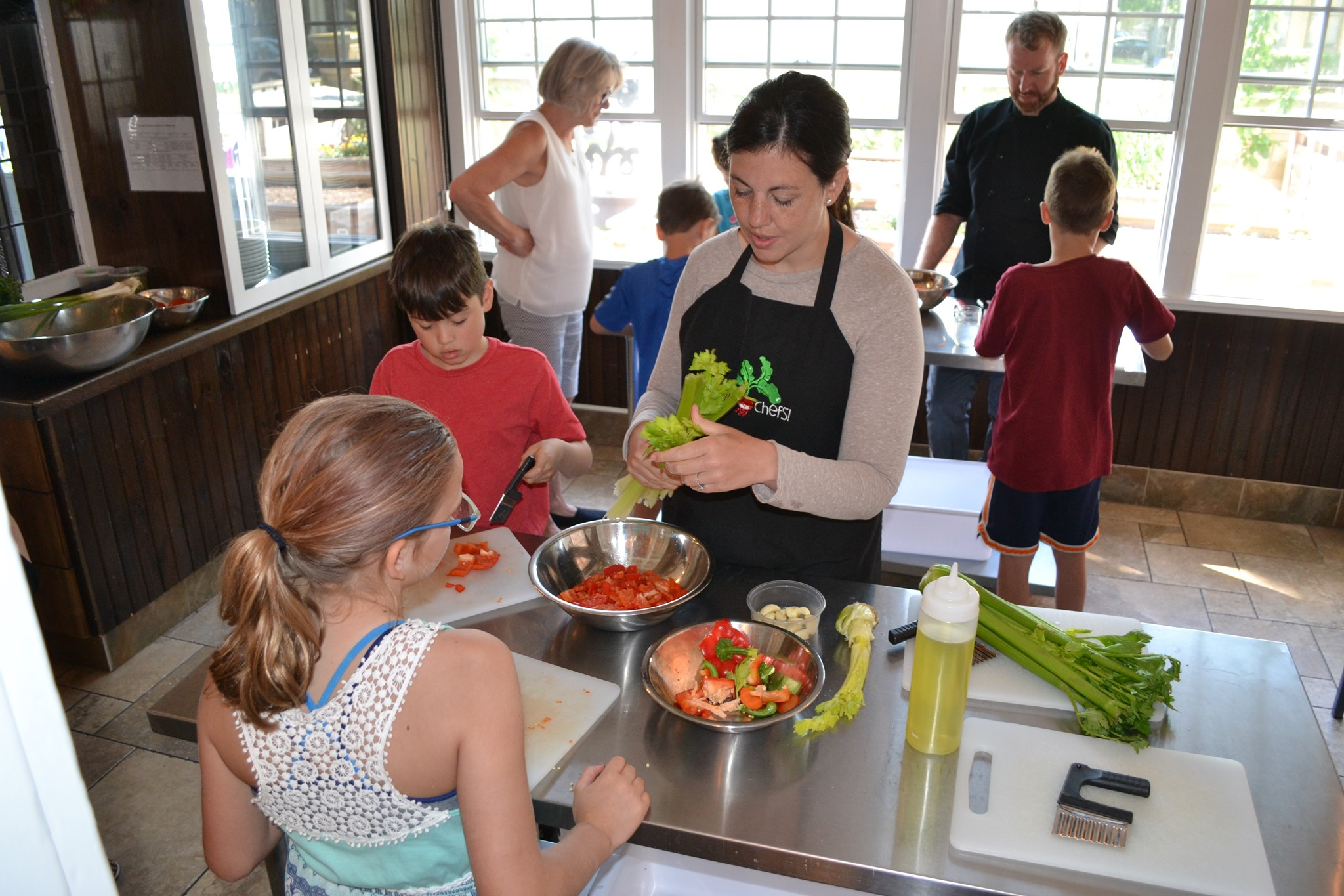 A chef teaches kids how to cook with healthy food