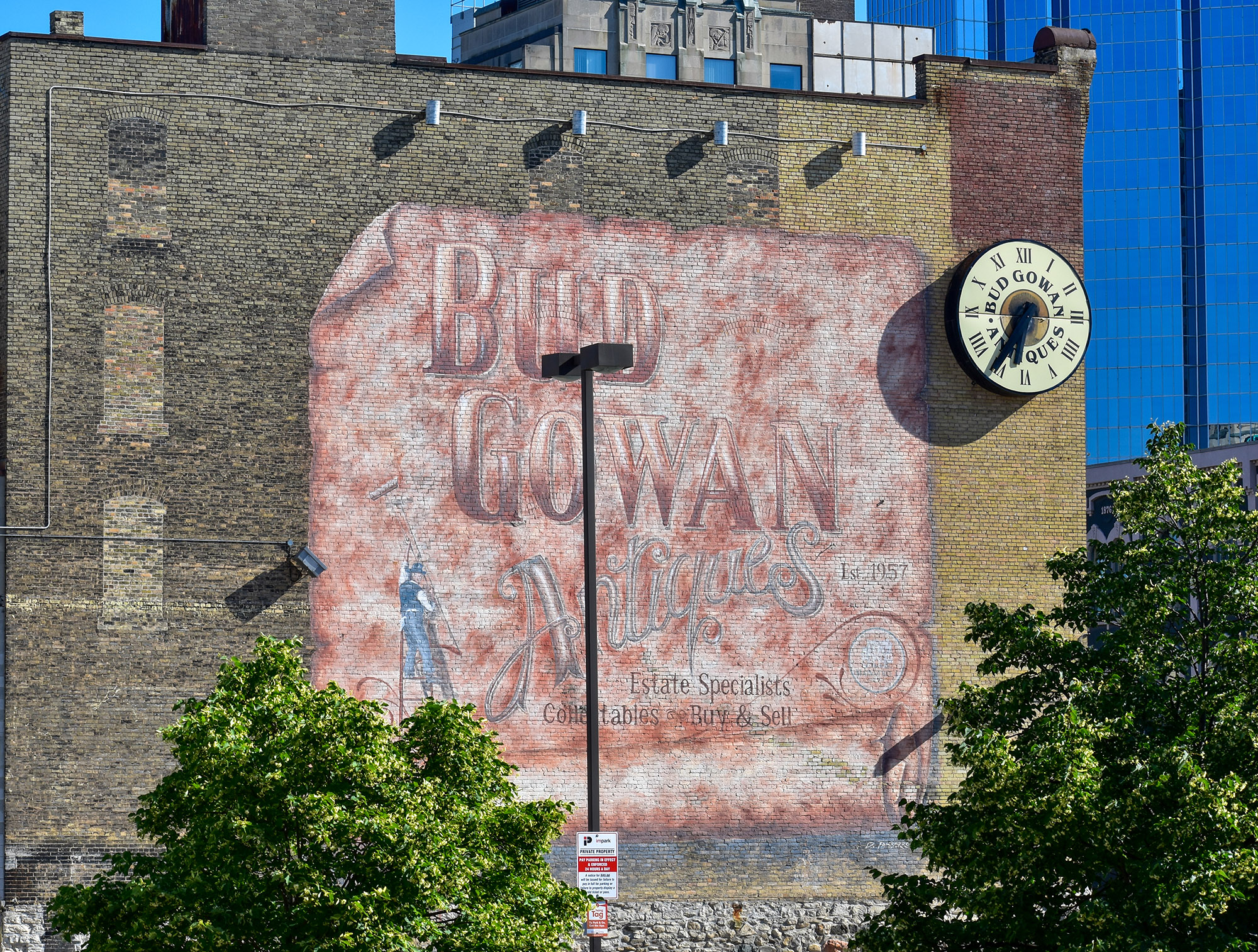 A painted wall advertises Bud Gowan Antiques