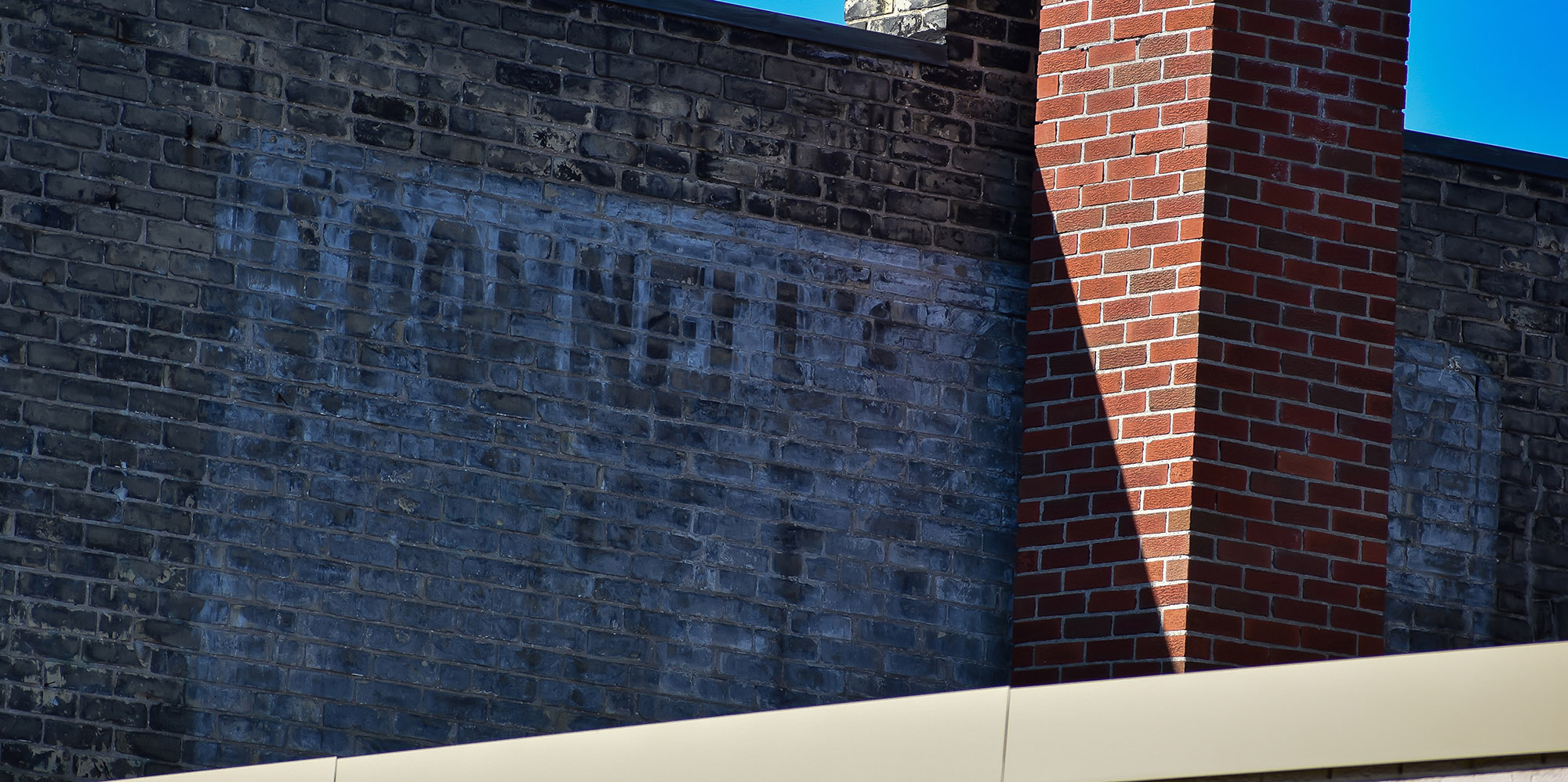 A ghost sign on a brick wall says O'Donnell