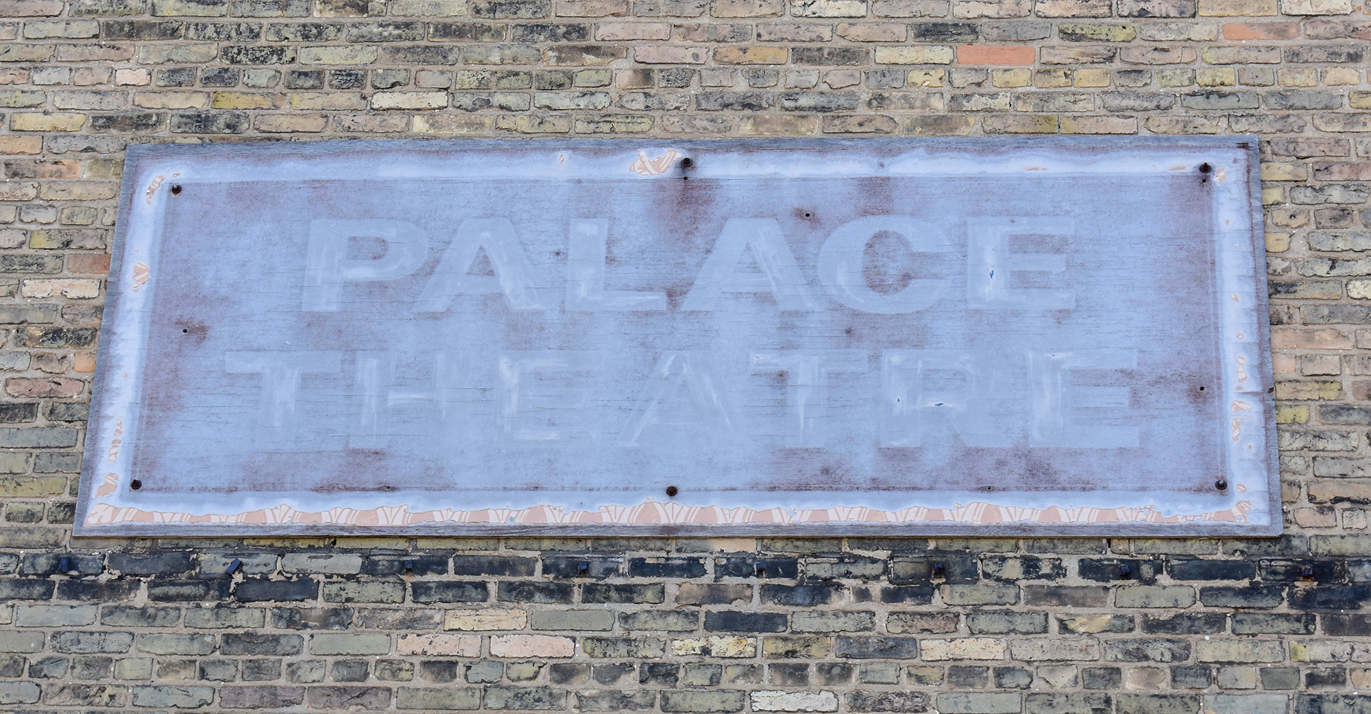 A faded sign says palace theatre