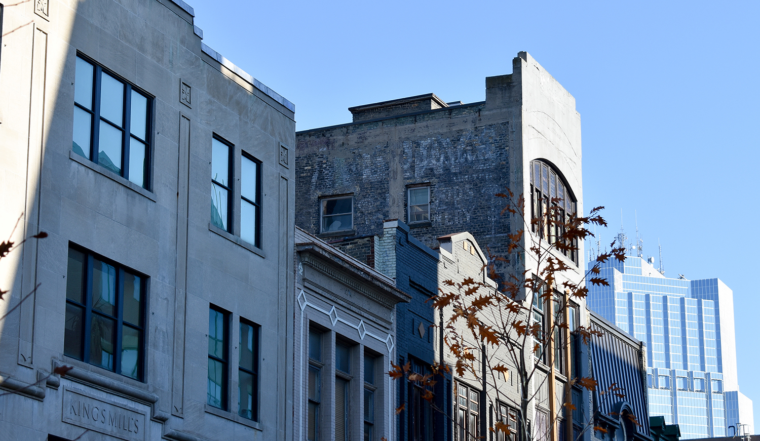 A faded ghost is stands out in a row of buildings