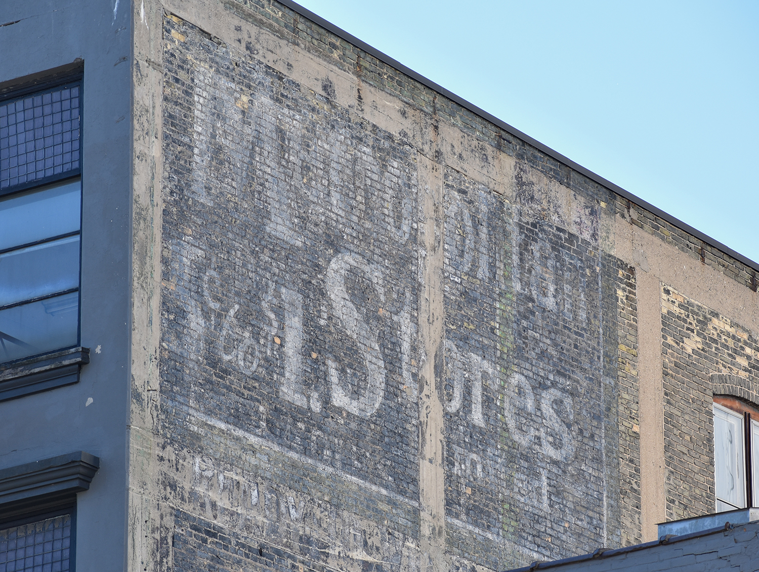 A faded sign says Metropolitan Stores