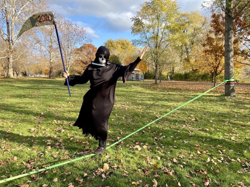 Hazel Whorley (The Grim Reaper) while slacklining in Gibbons Park for Halloween 2020 - Photo by Elizabeth McDonald