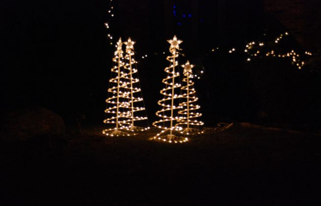 Four gold light trees with stars on top in Masonville in London ON