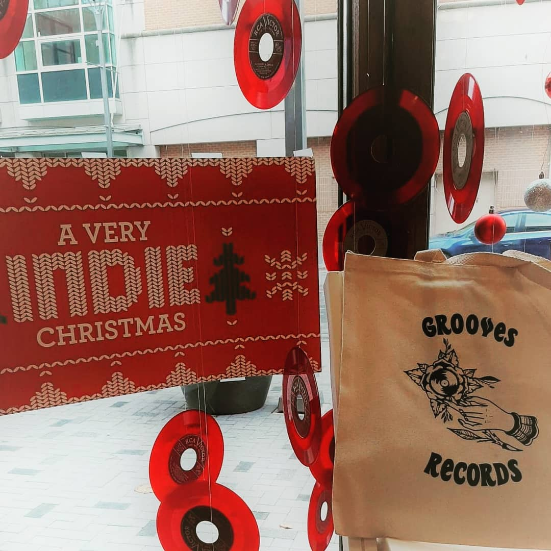 Grooves Records Gift bag and sign that says have a very indie Christmas.