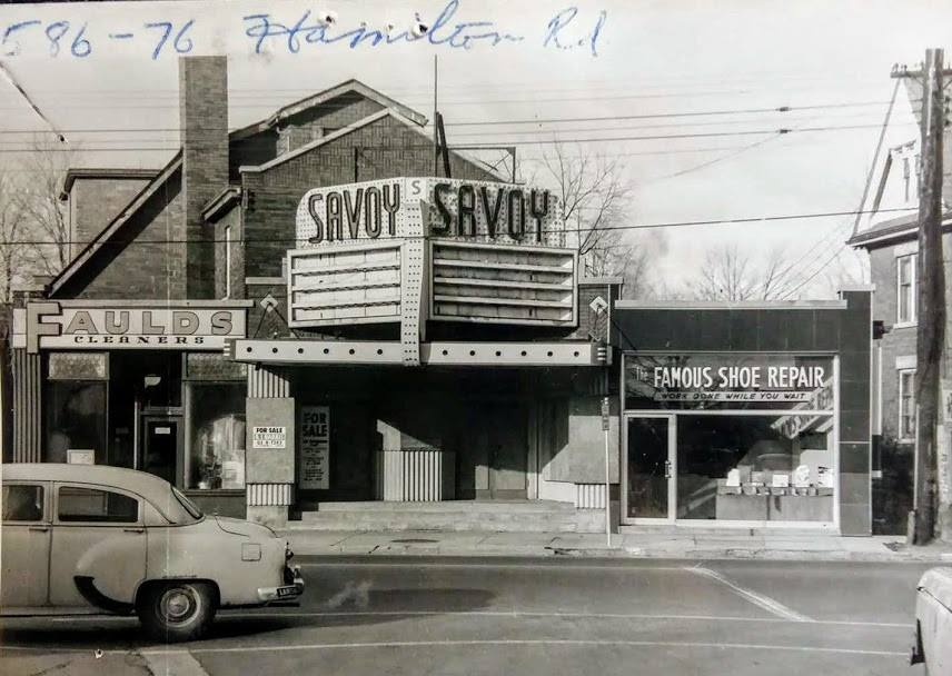 A black and white photo of the outside of a Hamilton Road theatre. The top of the marque says Savoy.