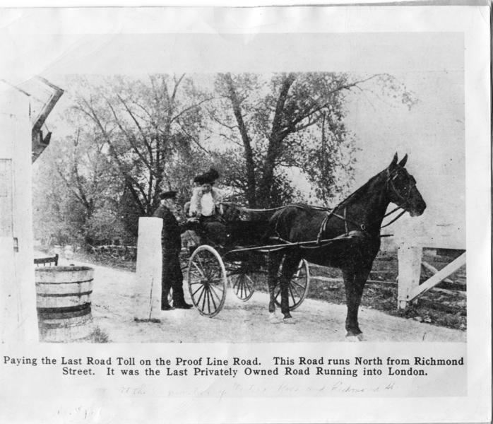 A b&w photo of a large horse pullying a carriage, a woman takes the hands of a man as she exits the carriage.
