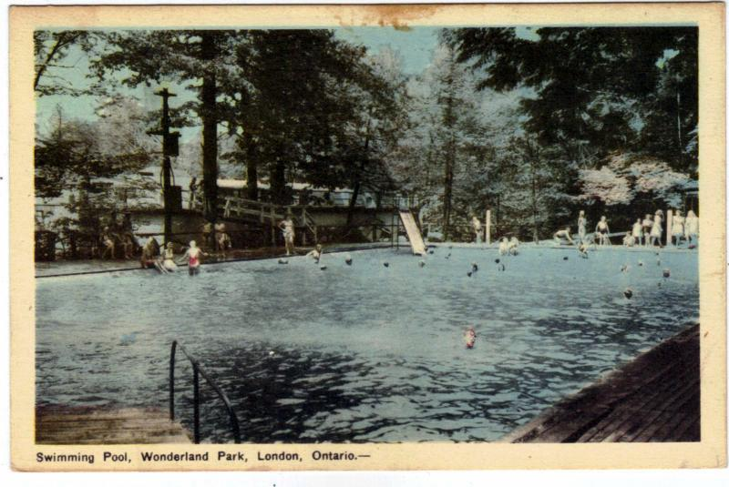 """A postcard with an illustration of a large swimming pool with blue water, a slide, and happy swimmers. The bottom of the card says """"Swimming Pool, Wonderland Park, London, Ontario."""""""