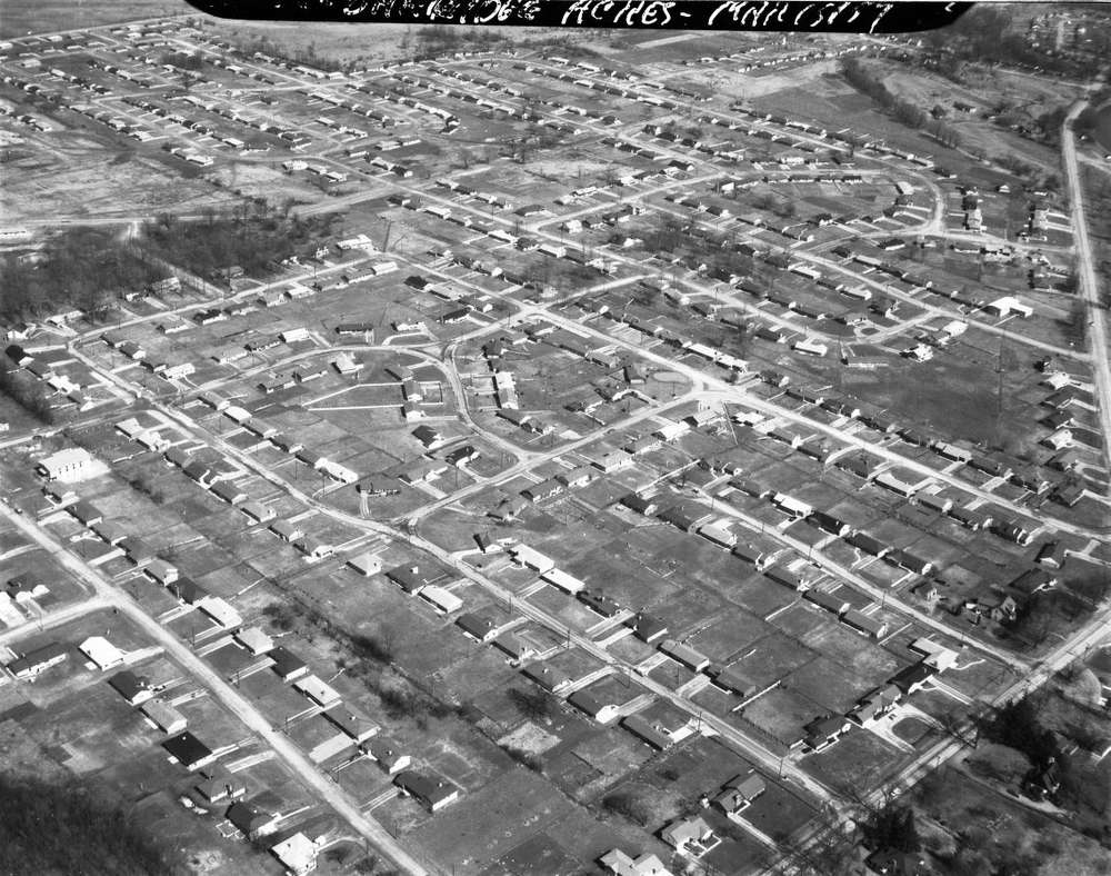A black and white aerial photo of Oakridge Acres, with streets laid out like a grid.