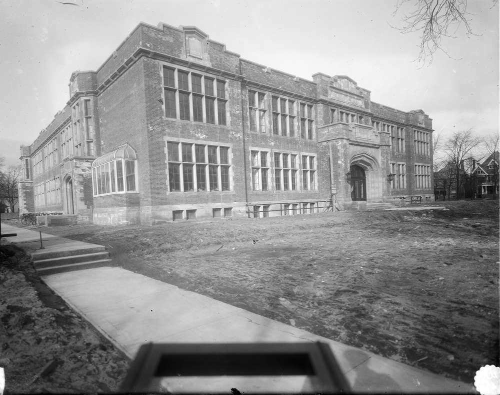 A black and white photo of a brick, two-story school under construction in Woodfield, London, Ontario