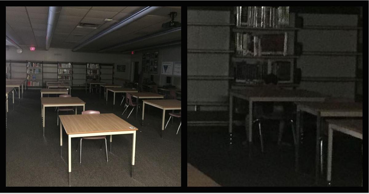 A photo of a row of desks with what looks like a student sitting at a far desk.