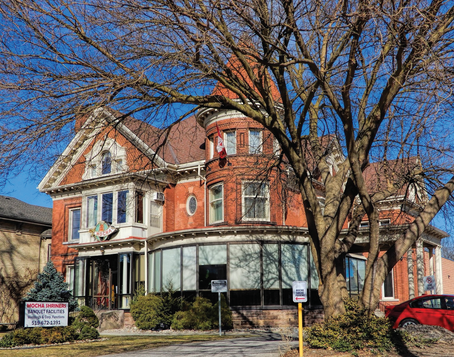A large red brick mansion in Woodfield