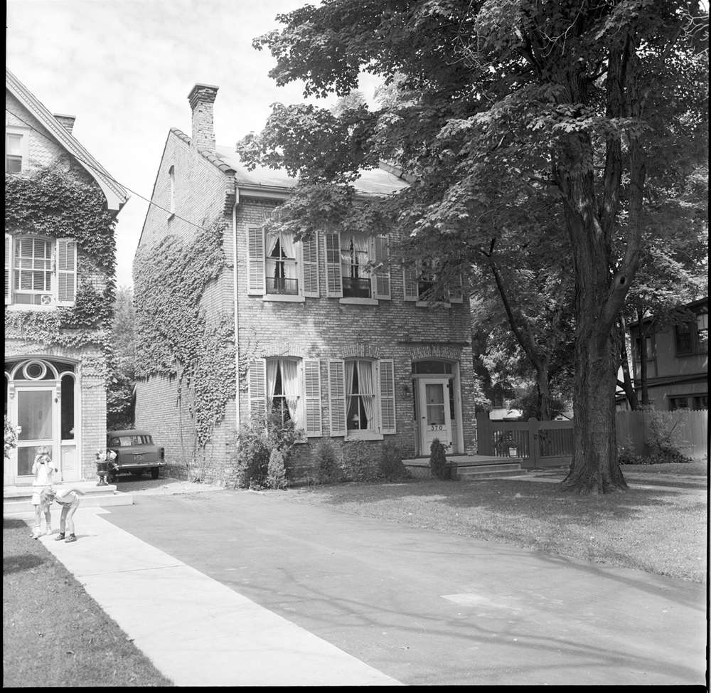 A black and white photo of the sister houses in Woodfield.