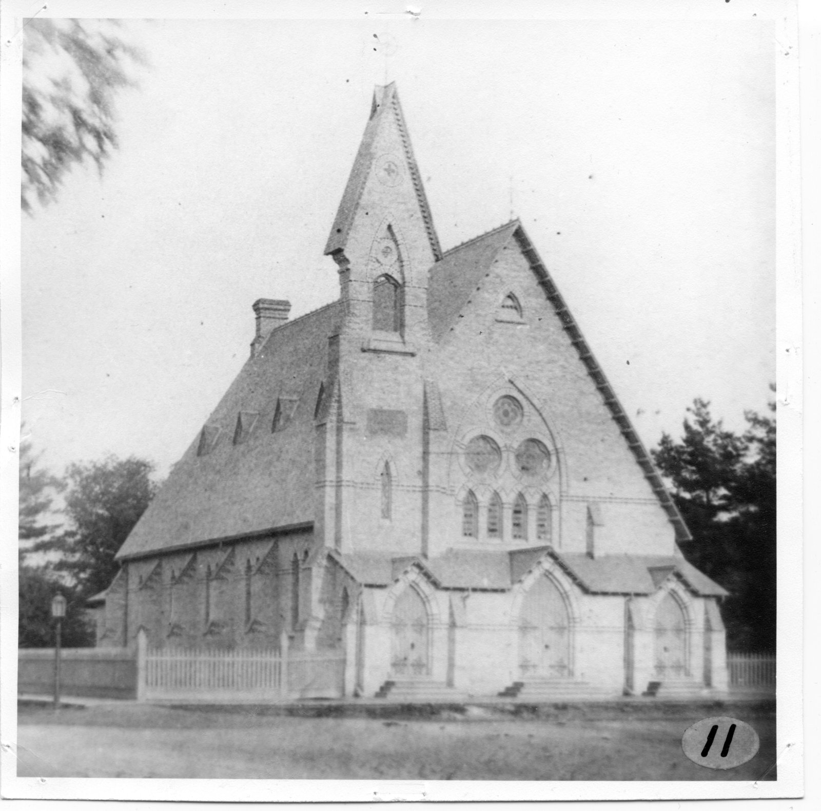 A black and white print showing a front and side view of Bishop Cronyn Memorial Church in Midtown.