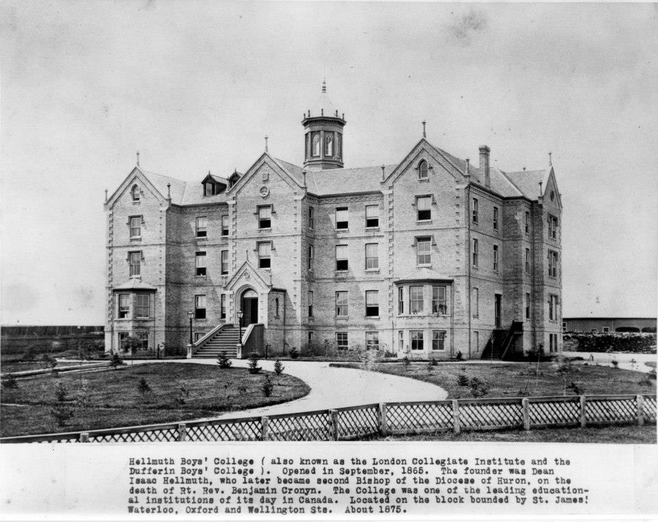A black and white photograph showing the face and one side of the Collegiate Institute (Hellmuth Boys'College) with a covered shed in the background.