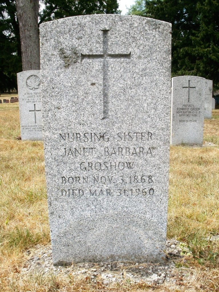 """A gravestone with a cross at the top. The stone reads """"Nursing Sister Janet Barbara Groshow Born Nov 3, 1868, Died Mar 31, 1960."""""""