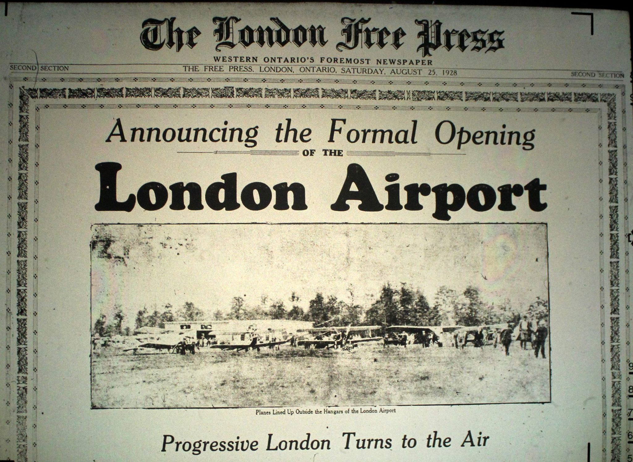 "The front page of The London Free Press newspaper. The headline text reads ""Announcing the Formal Opening Of The London Airport - Progressive London Turns to the Air"""