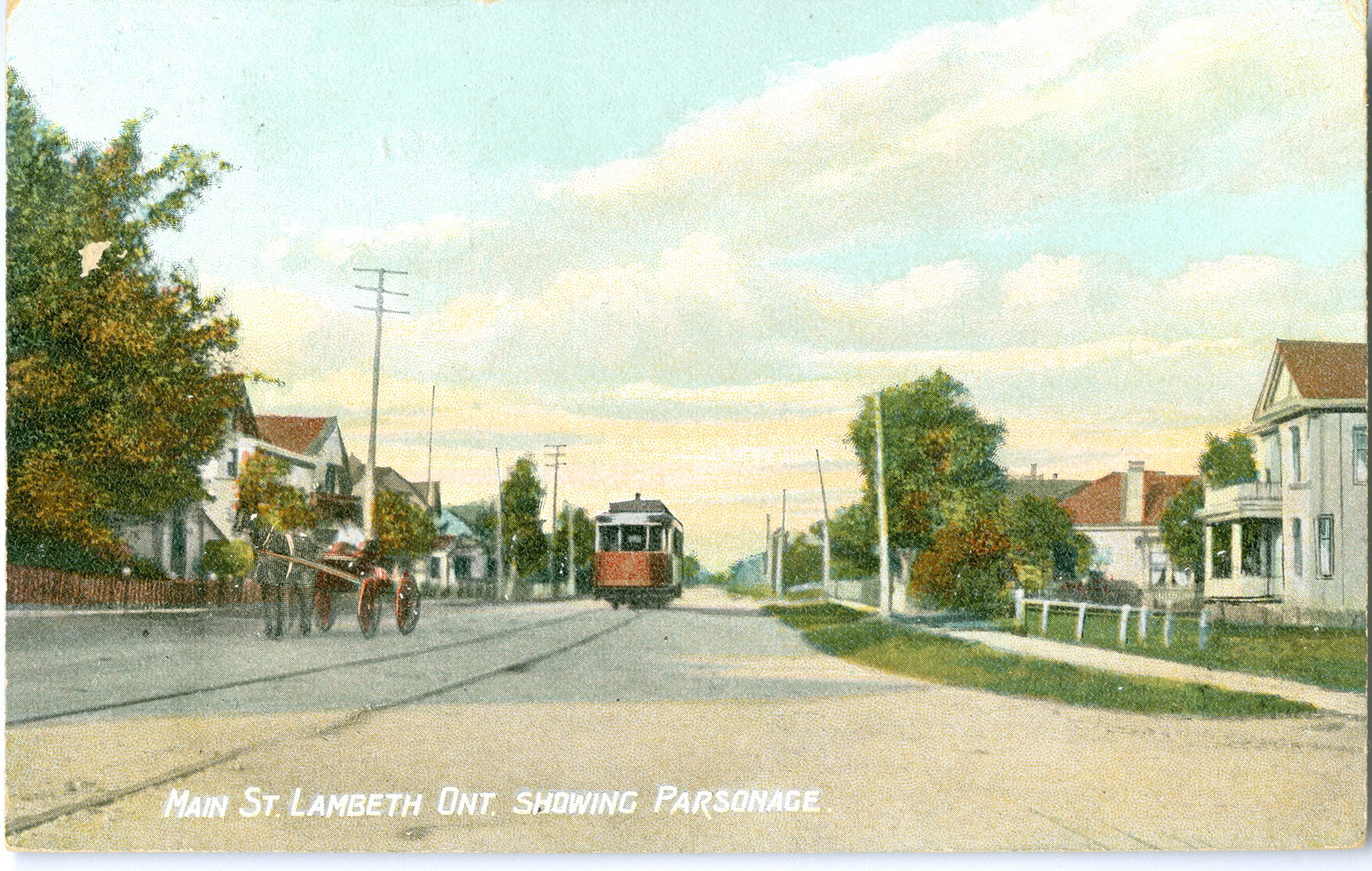 "Postcard image of a road with ouses lining each side. A horse and buggy are in the front with a rail car behind it. The text reads ""Main St. Lambeth Ont Showing Parsonage"""