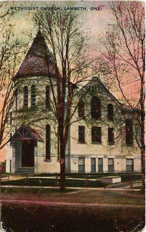 "A church stands being some barren trees in this postcard. The text reads ""Methodist Church, Lambeth, ONT"""