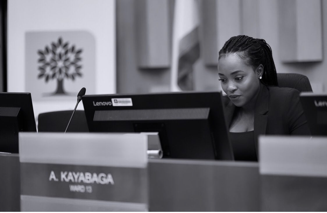 London city Councillor Arielle Kayabaga focuses on computer screen, working intently.