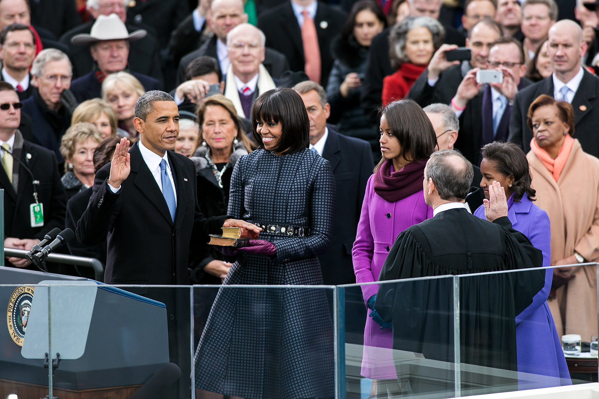 Barack Obama holds up his right hand as he's sworn in as POTUS