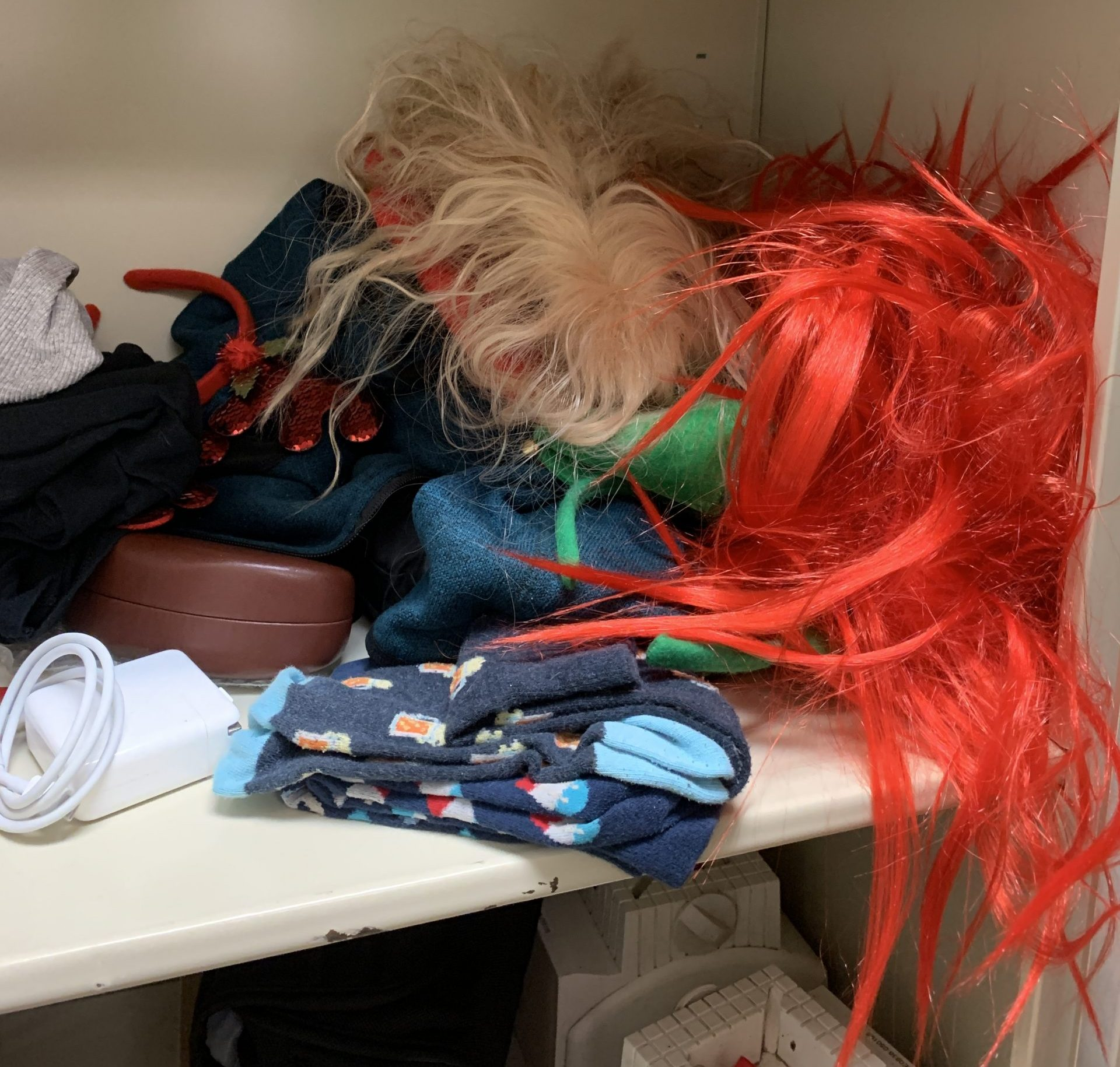 A pile of wigs and costume accessories